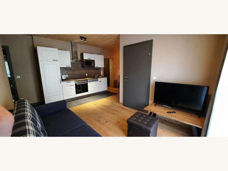 Wohnraum & Küche - Eigentumswohnung Unken - Bild 1